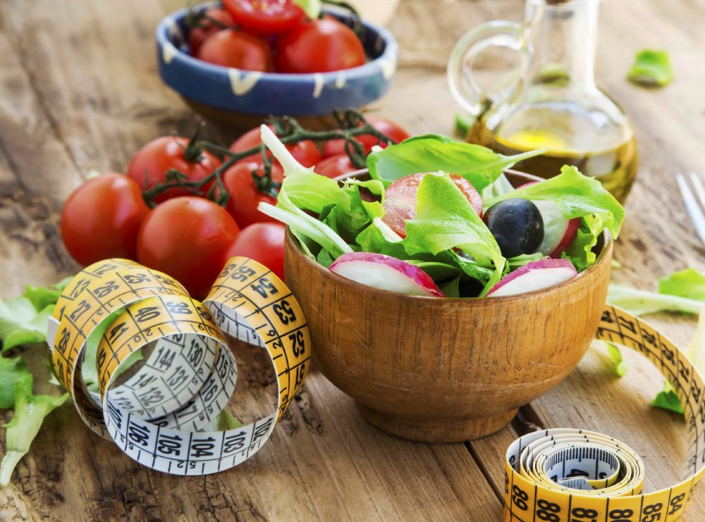 Healthy Vegetables Salad with Measure Tape.Diet Concept